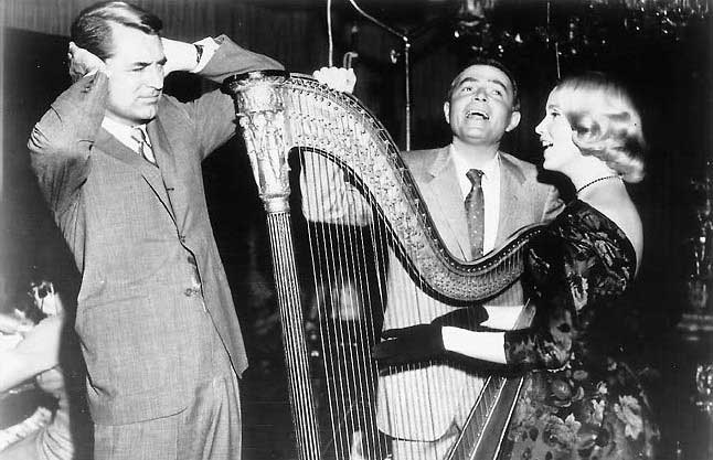 Cary-Grant-and-James-Mason-listening-to-Eva-Maie-Saint-playing-the-harp-on-the-set-of-North-by-Northwest