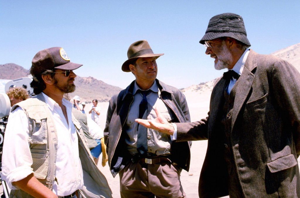 Director Steven Spielberg, Harrison Ford, Sean Connery on the set of INDIANA JONES AND THE LAST CRUSADE, 1989, (c) Paramount/courtesy Everett Collection
