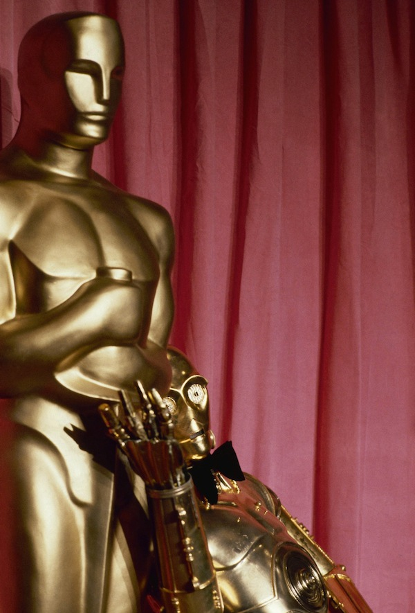 C-3PO, the robot character from the fictional Star Wars universe, is shown in front of a giant Oscar at the 50th Academy Awards in Los Angeles, April 3, 1978. (AP Photo)