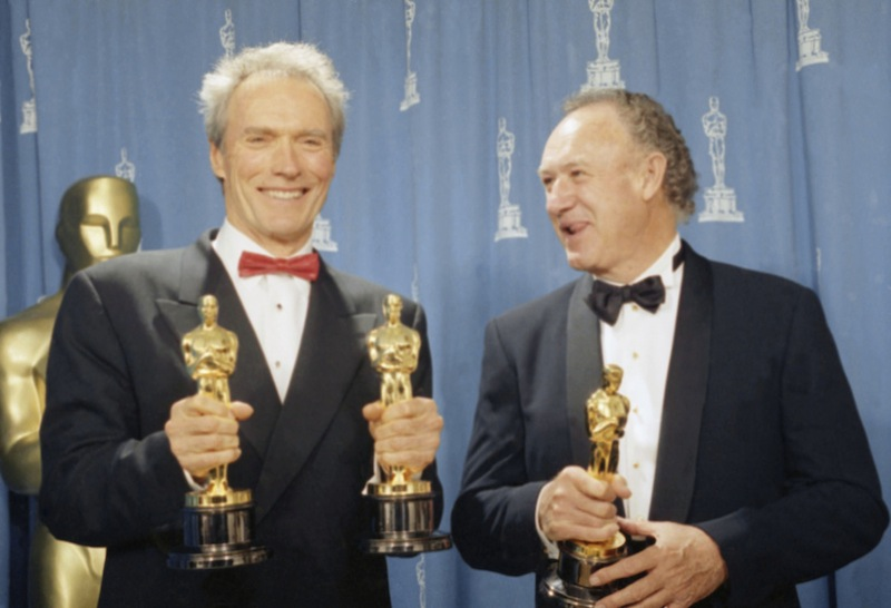 "Actor Clint Eastwood, left, and Gene Hackman hold their Oscars backstage at the 65th Annual Academy Awards in Los Angeles, Monday, March 30, 1993. Eastwood won directing the best film for the move ""Unforgiven"" and Hackman won best supporting actor for the same film. (AP Photo/Douglas C. Pizac)"