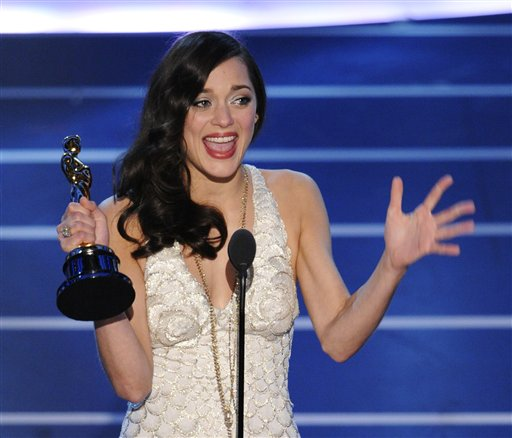 "**EMBARGOED AT THE REQUEST OF THE ACADEMY OF MOTION PICTURE ARTS & SCIENCES FOR USE UPON CONCLUSION OF THE ACADEMY AWARDS TELECAST** French actress Marion Cotillard accepts the Oscar for best actress for her work in ""La Vie en Rose"" the 80th Academy Awards Sunday, Feb. 24, 2008, in Los Angeles. (AP Photo/Mark J. Terrill)"