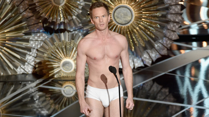 HOLLYWOOD, CA - FEBRUARY 22: Host Neil Patrick Harris stands unclothed onstage during the 87th Annual Academy Awards at Dolby Theatre on February 22, 2015 in Hollywood, California. (Photo by Kevin Winter/Getty Images)