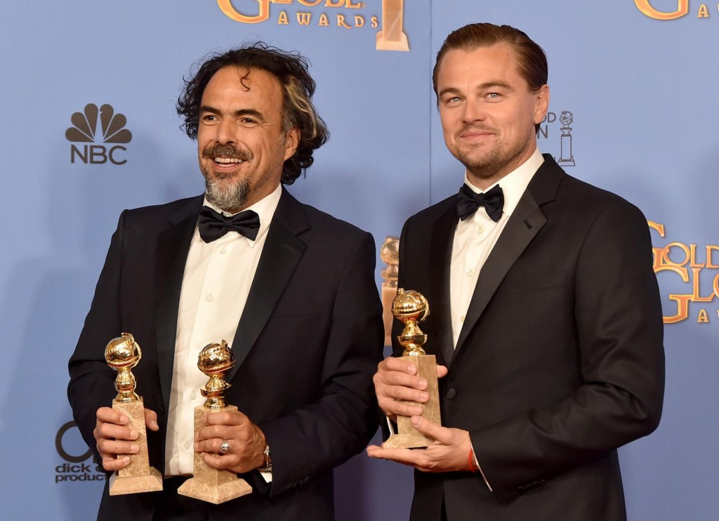 "BEVERLY HILLS, CA - JANUARY 10: Director Alejandro Gonzalez Inarritu (L), winner of Best Motion Picture - Drama and Best Director - Motion Picture for ""The Revenant,"" and actor Leonardo DiCaprio, winner of Best Performance by an Actor in a Motion Picture - Drama for ""The Revenant,"" pose in the press room during the 73rd Annual Golden Globe Awards held at the Beverly Hilton Hotel on January 10, 2016 in Beverly Hills, California. (Photo by Kevin Winter/Getty Images)"
