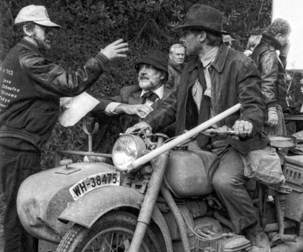 Steven Spielberg directs Harrison Ford (Indiana Jones) and Sean Connery (Professor Henry Jones).