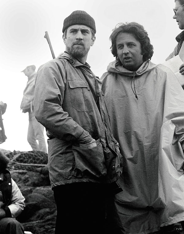 The Deer Hunter (1978) Directed by Michael Cimino Shown: Writer/director Michael Cimino with Robert De Niro (as Michael Vronsky)