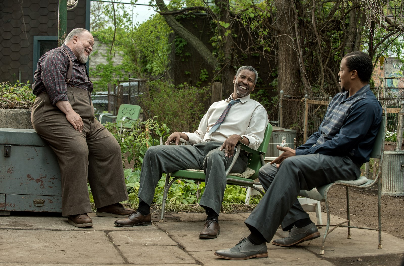 Stephen McKinley Henderson plays Jim Bono, Denzel Washington plays Troy Maxson and Russell Hornsby plays Lyons in Fences from Paramount Pictures. Directed by Denzel Washington from a screenplay by August Wilson.