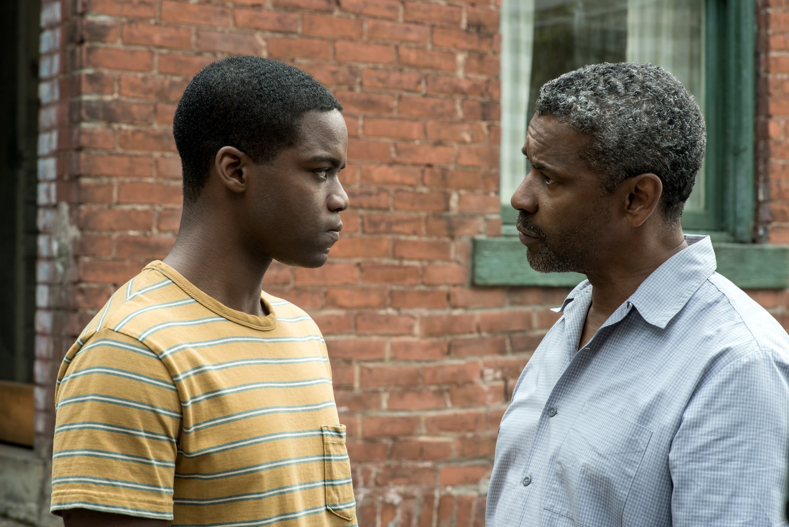 Denzel Washington plays Troy Maxson and Jovan Adepo plays Cory in Fences from Paramount Pictures. Directed by Denzel Washington from a screenplay by August Wilson.