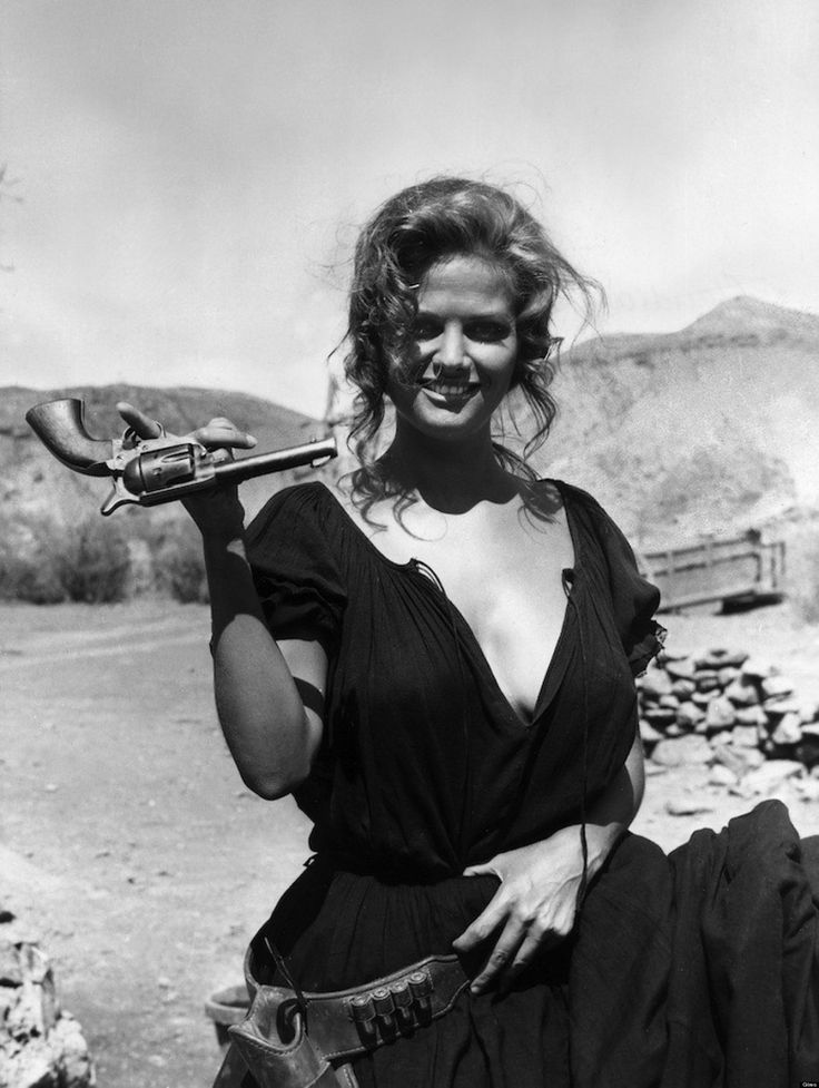 "FOTOGRAMA DE LA PELICULA "" ONCE UPON A TIME IN THE WEST "" EN LA FOTO LA ACTRIZ CLAUDIA CARDINALE CON UNA PISTOLA AP Photo / © RADIALPRESS 01/01/1968 *** Local Caption *** Italian actress Claudia Cardinale is pictured at the set in a scene of epic ""Once Upon a Time in the West"" lesurely holding a revolver with one finger. (AP Photo)© RADIAL PRESS"