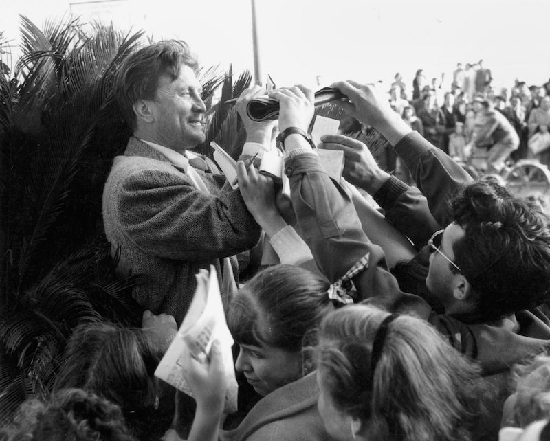 american_actor_kirk_douglas_signing_autographs_for_fans_at_the_international_cannes_film_festival_17th_april_1953._photo_by_rdagetty_images