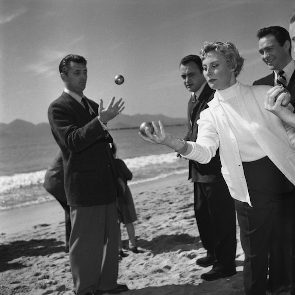 french_actress_michele_morgan_is_playing_french_petanque_game_with_robert_mitchum_during_the_international_film_festival_in_cannes_southern_france_in_1950._photo_by_reporters_associesgamma-rapho_vi